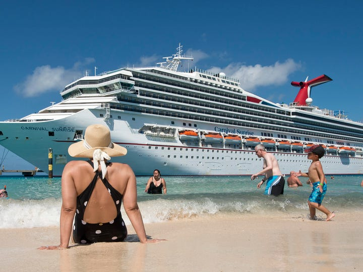 Guests enjoy the beach while the Carnival Sunrise is docked in Grand Turk in the Bahamas. Photo by Andy Newman/Carnival Cruise Line