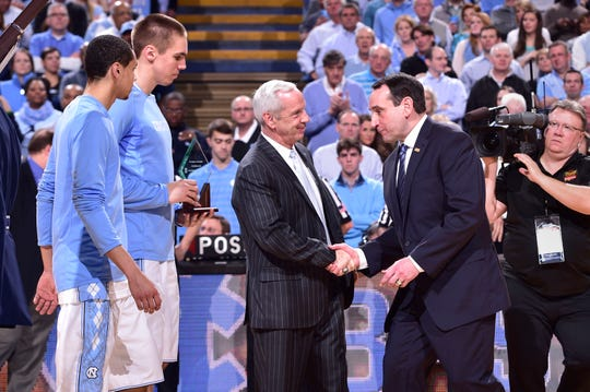 North Carolina Tar Heels head coach Roy Williams with Duke Blue Devils head coach Mike Krzyzewski have a rivalry on the court as well as the recruiting trail.