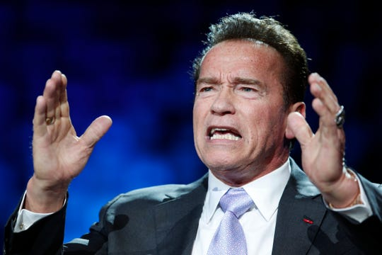 Former California Governor Arnold Schwarzenegger gives a speech at a planet summit outside Paris, France in 2017.