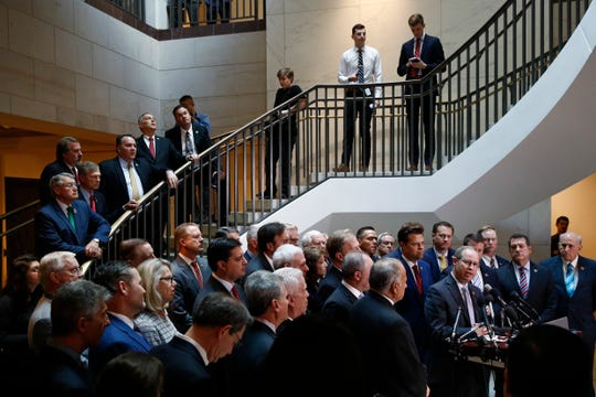 House Republicans gather for a news conference after Deputy Assistant Secretary of Defense Laura Cooper arrived for a closed door meeting to testify as part of the House impeachment inquiry into President Trump, Oct. 23, 2019, on Capitol Hill in Washington.