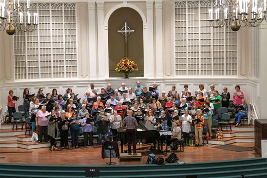 Don Campbell, conductor for the GAMAC Chorale, leads a rehearsal at Boulevard Baptist Church in Anderson Tuesday. The Masterworks Series of GAMAC presents With One A-Chord Friday, November 1, featuring many songs popular with patrons of GAMAC.
