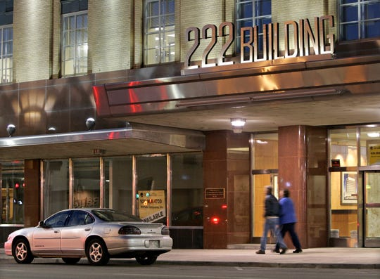 In an archived photo, pedestrians walk past the 222 Building in downtown Appleton.