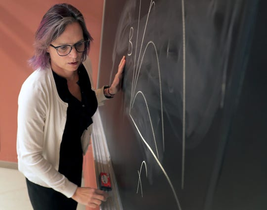 Associate professor and physics department chair Megan Pickett teaches an introductory physics course  Wednesday at Lawrence University.