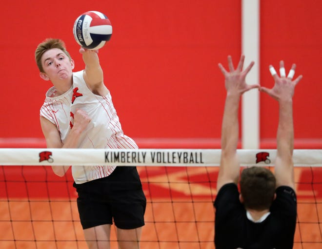 Kimberly's Spencer Herman hits a shot against Fond du Lac's Kegan Olig during their WIAA boys volleyball sectional semifinal match Oct. 29 in Kimberly.