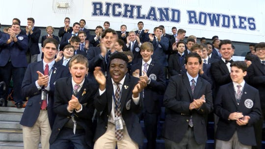 St. Augustine Prep students gets fired up during a taping of the Red Zone Road Show Tuesday, October 29, 2019, in Richland, NJ.  They will face Williamstown Friday night.