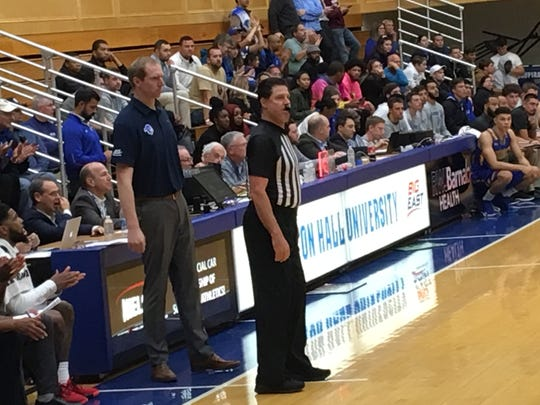 Grant Billmeier (standing, left) coaching Seton Hall against Misericordia.