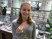 Brianne Sinks of Ocean Township shows the ring she found on Asbury Park beach that had been lost two years earlier by a Point Pleasant couple. It was returned Wednesday.