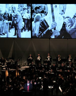 """Mayor Anthony Williams reads the words of Abraham Lincoln while images of post-Civil War racism after shown at the conclusion of """"Lincoln Portrait,"""" performed Saturday by the Abilene Philharmonic Orchestra. Oct. 26 2019"""