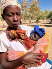 A Zambian woman with her baby.