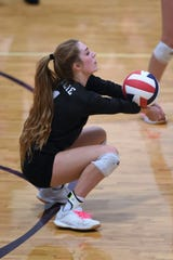 Wylie libero Pierson Sanders (1) digs out a serve against Cooper at Bulldog Gym on Tuesday, Oct. 29, 2019. The Lady Bulldogs won 3-1 in their final regular season match before the playoffs.