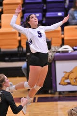 Wylie's Keetyn Davis (9) goes up for a kill against Cooper. After her four-year career with the Lady Bulldogs, Davis signed to play at Midwestern State on Wednesday morning.