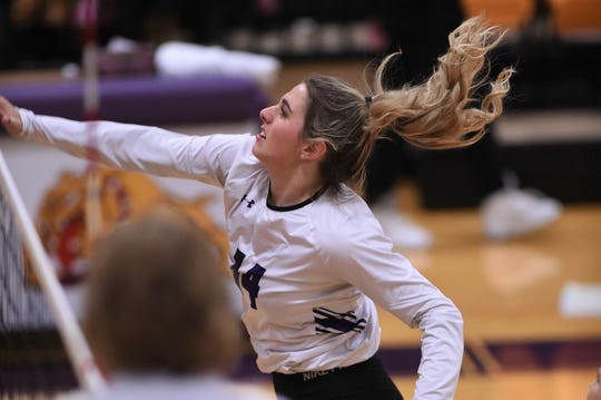 Wylie's Maggie Allen (14) finishes off a kill against Cooper at Bulldog Gym on Tuesday, Oct. 29, 2019. The Lady Bulldogs won 3-1 in their final regular season match before the playoffs.