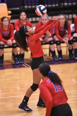 Cooper's Keiana Kemp (4) turns to bump the ball over the net against Wylie at Bulldog Gym on Tuesday, Oct. 29. 2019. Kemp finished with 11 kills in the Lady Cougars 3-1 setback.