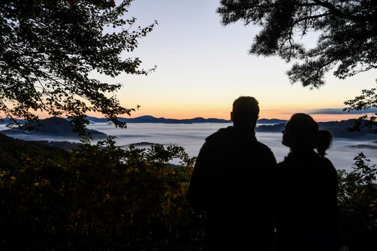 Heather Burditt looks up at Brandon Askew as they wait for the sun to rise along the Blue Ridge Parkway October 28, 2019.