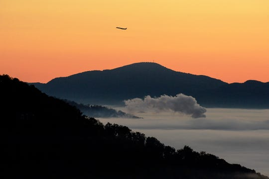 A plane takes off from Asheville Regional Airport before sunrise October 28, 2019.