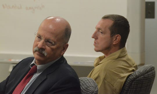 Defense attorney John sullivan and Thomas Swarmes listen to the jury verdict.
