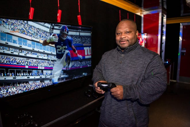Entrepreneur Michael Guest poses for a portrait inside his video game trailer on Tuesday, Oct. 29, 2019 in Battle Creek, Mich. Guest started his business, Big Tym Fun, so he could have something to pass down to his niece and nephews.