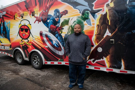 Entrepreneur Michael Guest poses for a portrait outside of his video game trailer on Tuesday, Oct. 29, 2019 in Battle Creek, Mich. Guest started his business, Big Tym Fun, so he could have something to pass down to his niece and nephews.