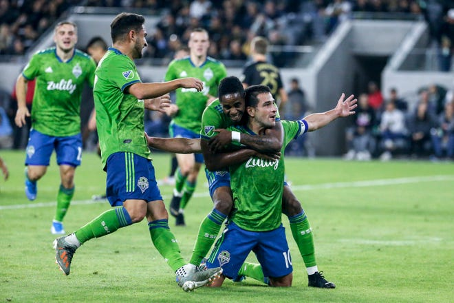 Seattle Sounders midfielder Nicolas Lodeiro, right, celebrates his goal with teammates during the first half of the MLS soccer Western Conference final against Los Angeles FC, Tuesday, Oct. 29, 2019, in Los Angeles.