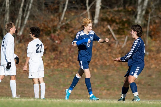 MMU's Liam Thompson (5) celebrates a goal with Asher Symanowicz (23) during the high school boys semifinal soccer game between the Burlington Seahorses and the Mount Mansfield Cougars at MMU High School on Tuesday afternoon October 29, 2019 in Jericho, Vermont.