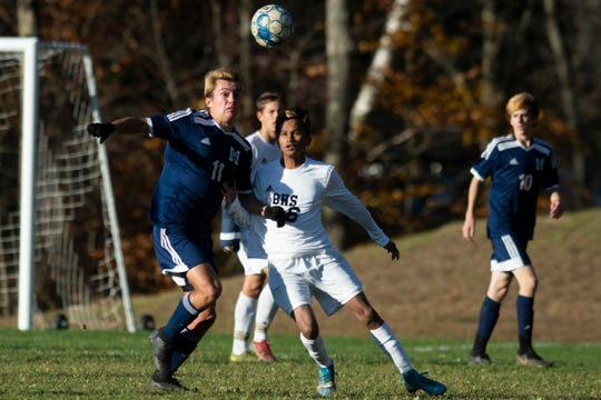 MMU's Adrien Monks (11) battles for the ball with Burlington's Arjun Karki (6) during the high school boys semifinal soccer game between the Burlington Seahorses and the Mount Mansfield Cougars at MMU High School on Tuesday afternoon October 29, 2019 in Jericho, Vermont.