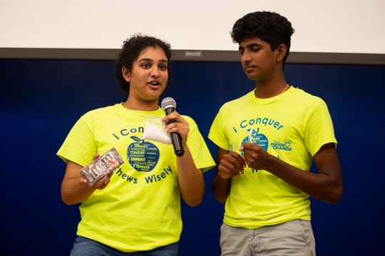 Incarnate Word Academy senior Sneha Reddy and her brother Incarnate Word Academy junior Pranai teach Windsor Park students how much sugar is in soda and snacks as they lead their program iConquer Kids Brain Health. The program they created teaches elementary children how to develop a healthy brain through good nutrition, an active lifestyle, behavior and learning.