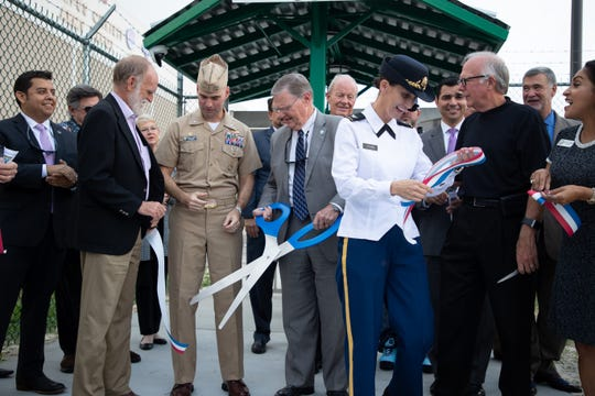 Officials take part in a ribbon cutting ceremony at Naval Air Station Corpus Christi for an underground water pipeline extension project and a security enclave project at Corpus Christi Army Depot on Wednesday, Oct. 30, 2019.