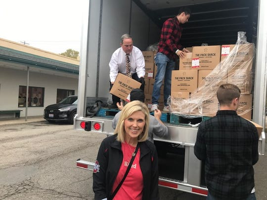 "Tracy Stuck speaks about OSU Student Life's ""Kindness Initiative"" as former OSU football player Ken Blair III unloads a box full of pre-packaged meals the morning of Oct. 30, 2019."