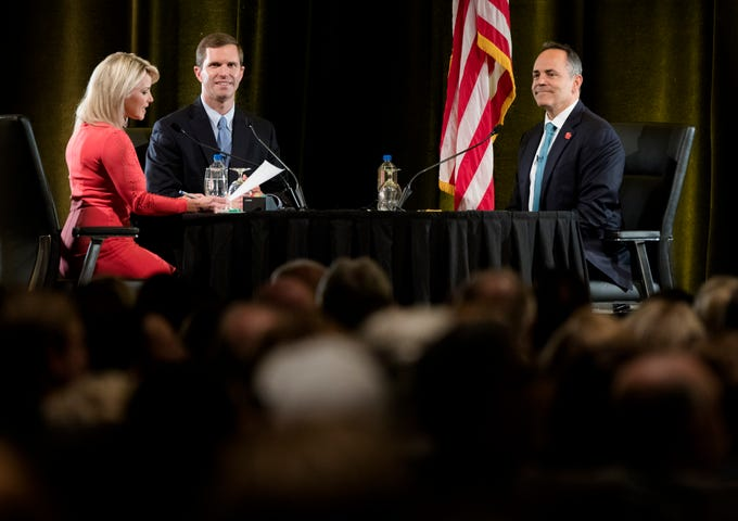 Sheree Paolello, WLWT, acts as moderator to Governor Matt Bevin, right, and Andy Beshear, center, during the final Kentucky gubernatorial debate between incumbent Republican Matt Bevin and Democratic candidate Andy Beshear on Tuesday, Oct. 29, 2019 at Northern Kentucky University in Highland Heights, Ky.