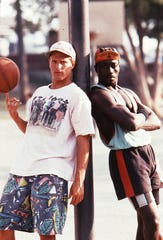 """Sidney Deane (Wesley Snipes) and Billy Hoyle (Woody Harrelson, left) are running a fast, funny, sometimes risky con game on L.A.'s toughest basketball courts in """"White Men Can't Jump."""""""