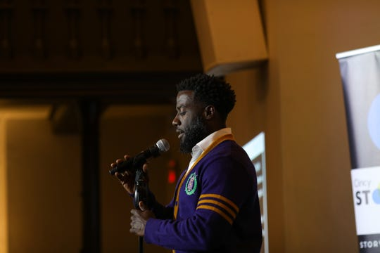 Rodrico Epps, a pharmaceutical representative with GSK, tells his story at Cincinnati Storytellers: Growing Up on Tuesday Oct. 29, 2019.
