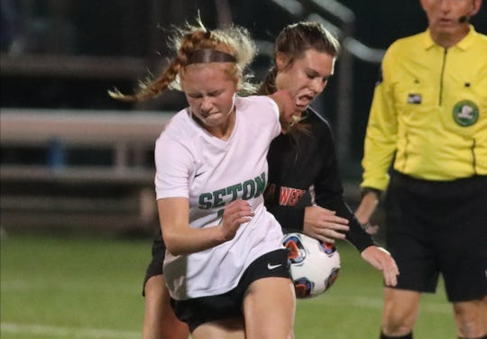 Seton player Olivia Mohs (20) battles Lakota West playe Savannah Grubbs (12) for the ball.