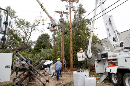 Electric crews and lineman work to replace poles and restore powers for the transformer at Mark's Car Connection in Clarksville, Tenn., on Tuesday, Oct. 29, 2019.