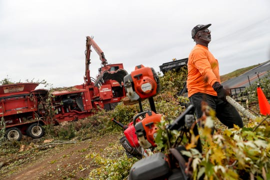 Larry Barefield pulls out limbs he picked up from neighbors to drop at the dump at Bi-County Solid Waste Management in Woodlawn, Tenn., on Tuesday, Oct. 29, 2019.