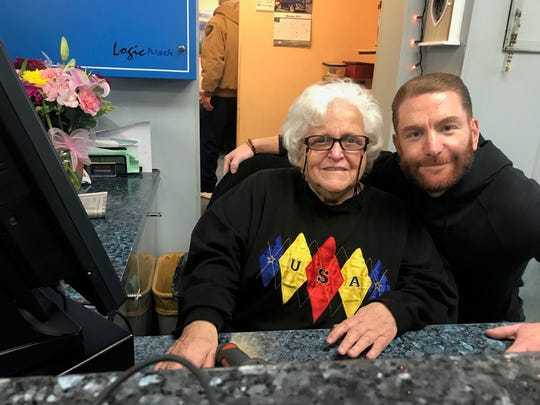 Lucy Sisko, here with owner Leon Beyder, has seen much in her 55 years behind the till at Woodbridge Car Wash. A fixture in the community, Sisko, 86, has found much joy in her longstanding employment. It's more than a day job — it's family.