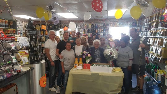 Lucy Sisko, 86, (center) has seen much in her 55 years behind the till at Woodbridge Car Wash. On Sept. 29, a surprise anniversary party was given in Sisko's honor.