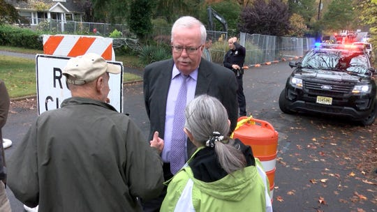 Woodbridge Mayor John McCormac speaks Wednesday, October 30, 2019, with residents near the scene where a plane crashed into home on Berkeley Avenue in Colonia.