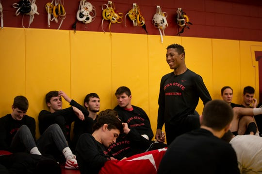 Iowa State's David Carr smiles as he talks with teammates during Iowa State Wrestling's media day on Tuesday, Oct. 29, 2019 in Ames.