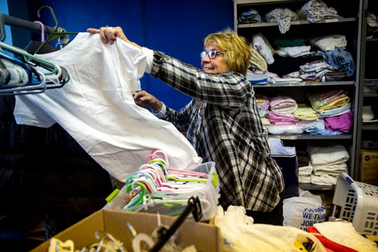 Alicia Van Bergen, of Ames, a volunteer for The Ankeny Klothing Exchange, organizes and hangs clothing donated to TAKE on Wednesday, Oct. 30, 2019, in their space on the third floor of the Neveln Center, in Ankeny.