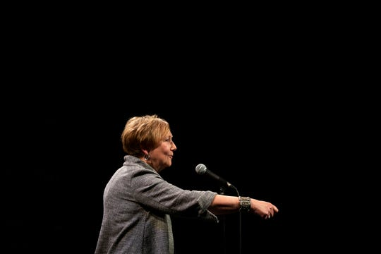 Suzanne Volkmer-Jones tells her story during the Des Moines Storytellers Project's True Tall Tales event on Tuesday, Oct. 29, 2019, at Hoyt Sherman Place in Des Moines.