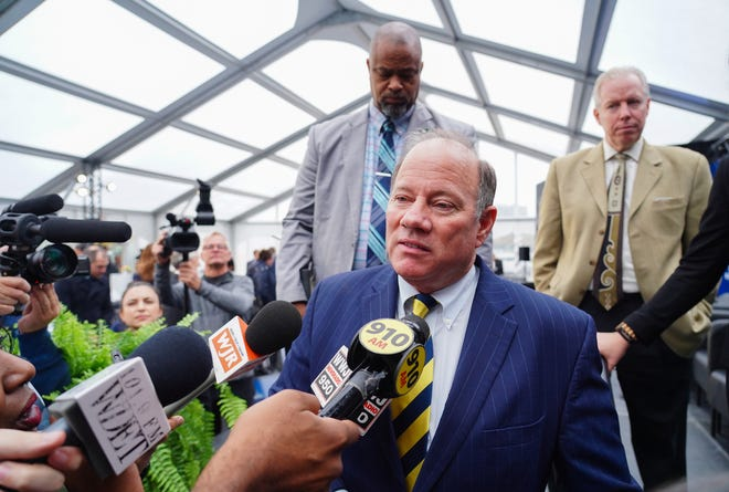 Detroit Mayor Mike Duggan speaks to media following a press conference on Wednesday, October 30, 2019 for the announcement of the new $300 million University of Michigan Research and Education Center and the 14-acre Detroit Center for Innovation at the site of the abandoned Wayne County Jail project in Detroit.