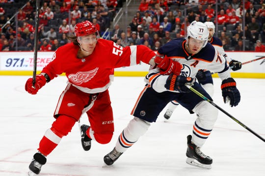 Detroit Red Wings left wing Tyler Bertuzzi (59) and Edmonton Oilers defenseman Oscar Klefbom (77) chase the puck in the second period of an NHL hockey game, Tuesday, Oct. 29, 2019, in Detroit.