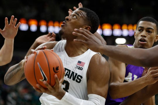 Michigan State forward Xavier Tillman looks to shoot during the second half of MSU's 85-50 exhibition win on Tuesday, Oct. 29, 2019, in East Lansing.