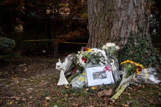 Photograph and flowers in memory of Logan and Briggs Connolly are left outside the house on the 700 block of Fisher Road in Grosse Pointe, Tuesday, Oct. 29, 2019.