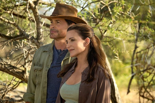 """Rob Lowe and Kristin Davis in """"Holiday in the Wild."""""""