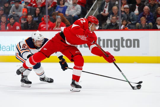 Detroit Red Wings center Andreas Athanasiou (72) shoots as Edmonton Oilers defenseman Matt Benning (83) defends in the second period of an NHL hockey game, Tuesday, Oct. 29, 2019, in Detroit.