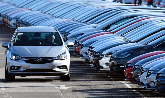 Cars branded with Opel badges are prepared for distribution at Vauxhall's production plant in Ellesmere Port, in Cheshire, north-west England, March 6, 2017.