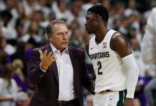 Tom Izzo talks with guard Rocket Watts Jr. during the first half of MSU's 85-50 exhibition win Tuesday.