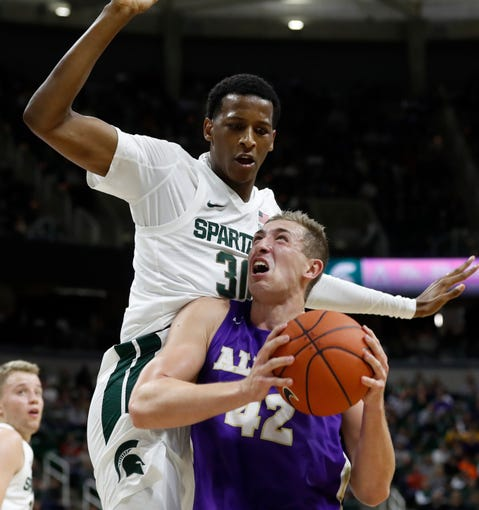 Albion forward Caden Ebeling is defended by Michigan State forward Marcus Bingham Jr. during the first half of MSU's 85-50 exhibition win on Tuesday, Oct. 29, 2019, in East Lansing.