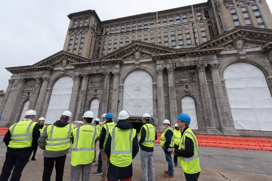Urban planners from California tour the Michigan Central Depot in Detroit.